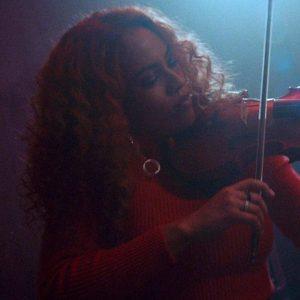 Ezinma playing the violin