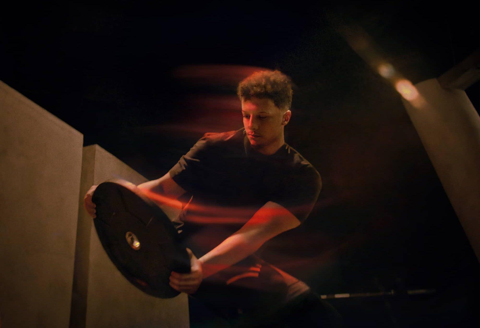 Patrick Mahomes lifting weights